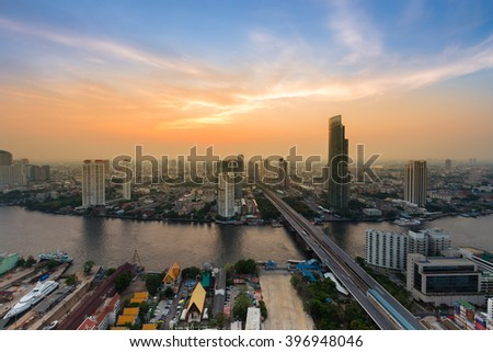Dramatic sky over Bangkok city downtown aerial view and main river curved, Thailand