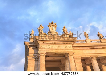 Dramatic sky over the statues and colonnade of St. Peter's Basilica at sunset.Beautiful architectural and natural landscape.Saint Peter Square ( Piazza San Pietro ).Vatican.Rome.Italy.Europe. - stock photo