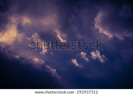 Dramatic sky with heavy clouds. Color toned image. - stock photo