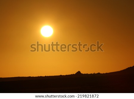 dramatic sky with sun - stock photo