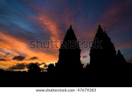 Dramatic sky with sun setting at Hindu temple Prambanan. Indonesia, Central Java, Yogyakarta - stock photo