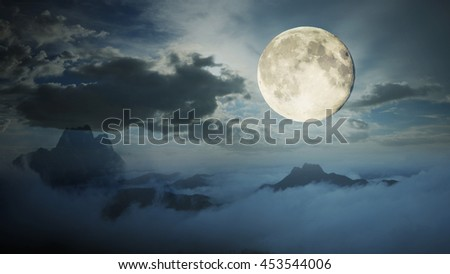 Dramatic sky with tree, full moon and clouds over mountain, Cool blue tone. - stock photo