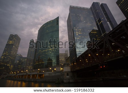 Dramatic Skyline of Chicago from Boat at Sunset - stock photo