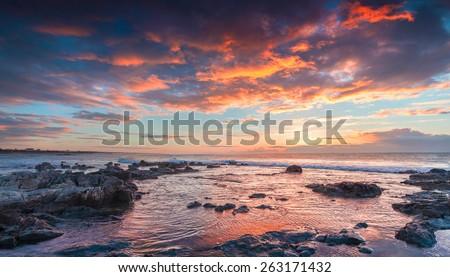 Dramatic spring sunrise on the Passero cape, Sicily, Italy, Tyrrhenian sea, Europe. - stock photo