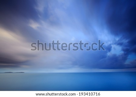 Dramatic storm cloud and sky at dusk.Long exposure technique  - stock photo
