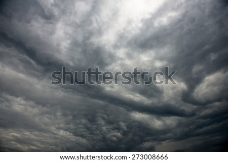 Dramatic storm cloudscape, with strange cloud shapes - stock photo