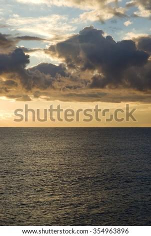 Dramatic stormy sky over sea - stock photo
