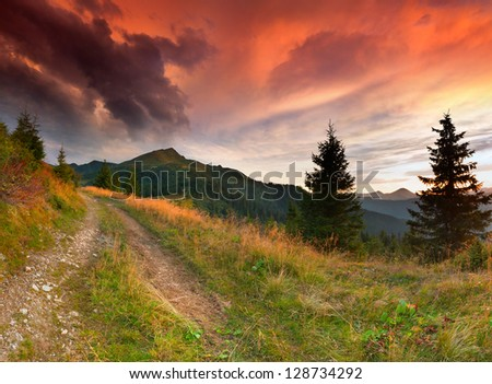 Dramatic summer landscape in the mountains. Sunrise - stock photo