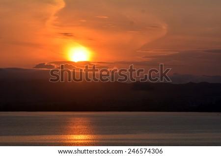 Dramatic sunrise over lake Rotorua, Bay of plenty, New Zealand. - stock photo