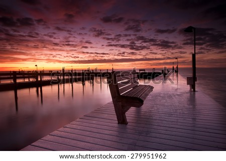 Dramatic sunrise. Sayville docks and marina. Long Island, New York .Atlantic ocean.   - stock photo