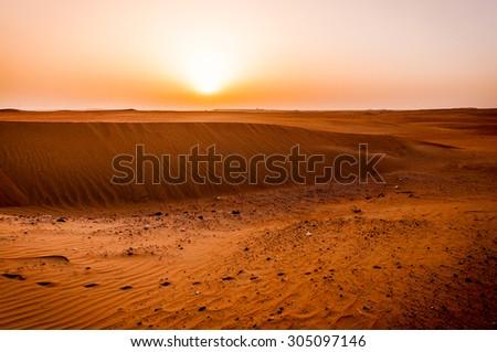 Dramatic sunrise view of Liwa Desert in the western region of Abu Dhabi - stock photo