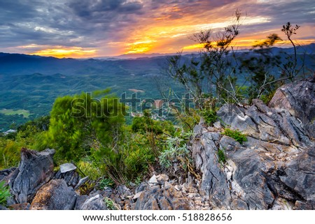 Dramatic sunrise view with ray of golden light of Gunung Baling, Kedah
