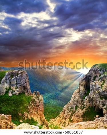 dramatic sunset in a mountains - stock photo