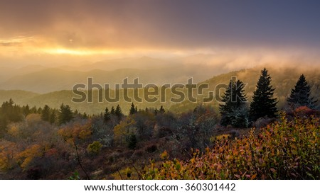Dramatic sunset in breaking fog over the Blue Ridge Mountains - stock photo