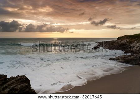 Dramatic sunset in Newquay, Cornwall, UK. - stock photo