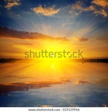 dramatic sunset on a lake - stock photo