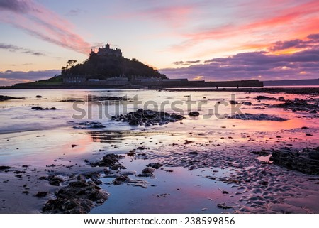 Dramatic sunset on the beach at Marazion with St Michaels Mount in the distance, Cornwall England UK Europe - stock photo