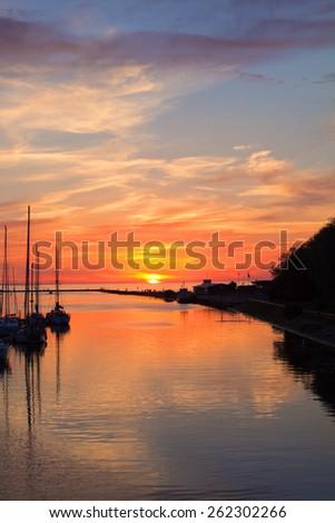 Dramatic sunset on the river - stock photo