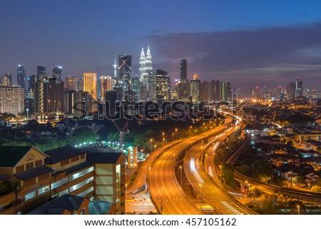 Dramatic sunset over Kuala Lumpur City Skyline - stock photo