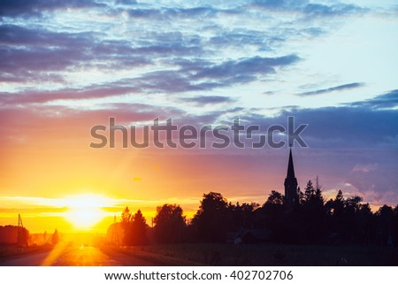 Dramatic sunset over road - stock photo