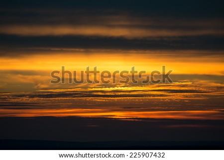 dramatic sunset photo with dark clouds - stock photo