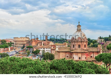 Dramatic sunset sky above the Church of Santi Luca e Martina and Great Roman Colosseum ( Colosseo, Coliseum, Flavian Amphitheatre ).Beautiful panoramic aerial view. Roman Forum. Rome. Italy.Europe. - stock photo