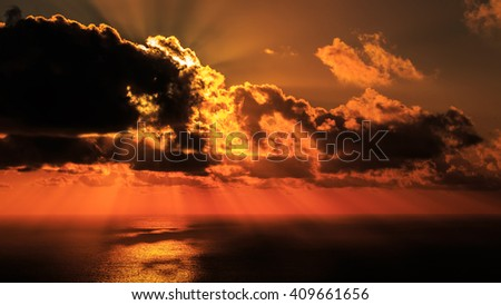 Dramatic Sunset with natural Sunrays over the sea