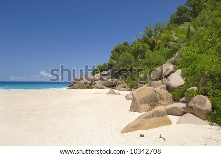 Dramatic unspoiled Grand Anse beach, inviting waters and tropical landscape of La Digue Island, Seychelles - stock photo