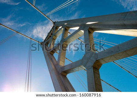 Dramatic view from below of the western span of the San Francisco-Oakland Bay Bridge - stock photo
