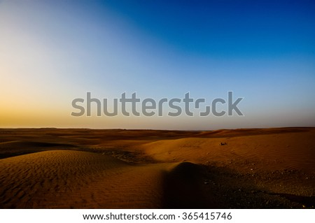 Dramatic view of the Liwa Desert in the Western Region of Abu Dhabi Over Sunrise - stock photo