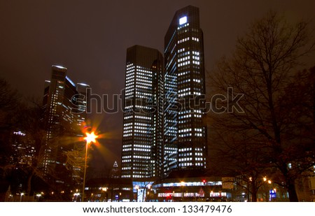 Dramatic wide angle perspective of the modern skyscrapers in Frankfurt city - stock photo