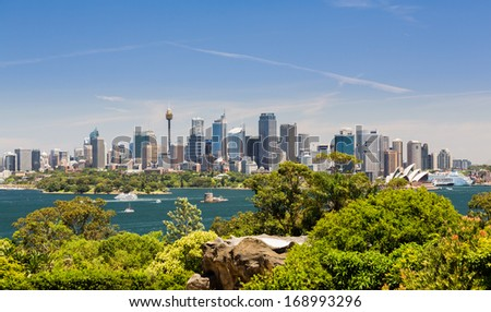 Dramatic widescreen panoramic image of the city of Sydney from Taronga Zoo with the Sydney Opera House and a broad view of the water in the harbour - stock photo
