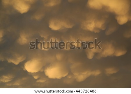 Dramatic yellow clouds after a thunderstorm during a summer evening. - stock photo