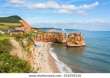 Dramtic red Jurassic cliffs and sea stacks  at Ladram Bay Devon England UK Europe - stock photo