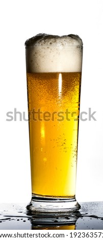 draught or draft beer on black reflex background with water drop on bottle - stock photo