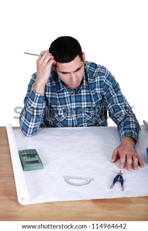Draughtsman working on a new drawing - stock photo