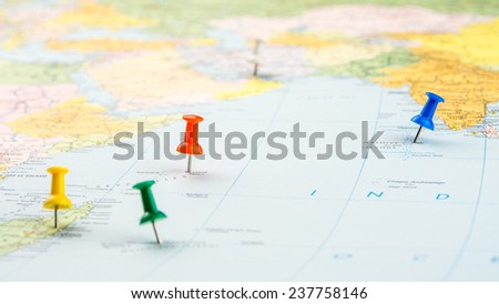 draw-pin stick into real map, identification of final destination, holiday in Indian Ocean - stock photo