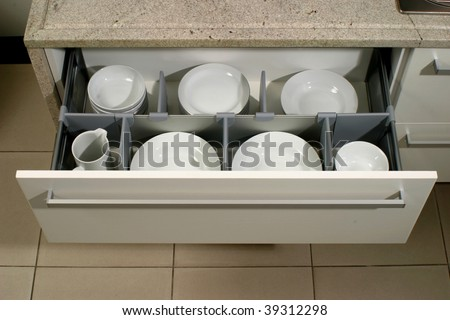 Drawer With Plates In A Modern Kitchen