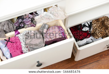 Drawers filled with sexy lace lingerie  - stock photo