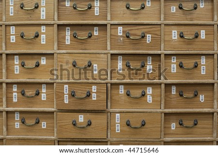 Drawers full of chinese herbal medicine in a pharmacy - stock photo