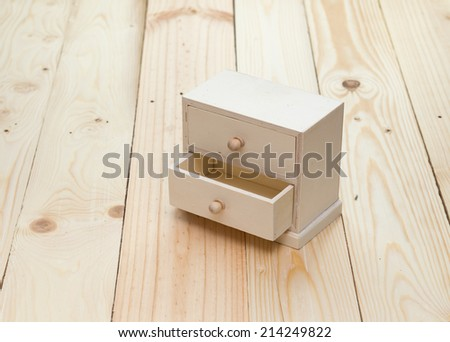 drawers on wooden background - stock photo