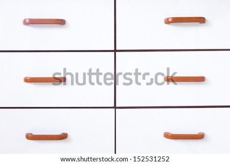 Drawers with wooden handles. Drawer and drawer handles are made of white wood. - stock photo