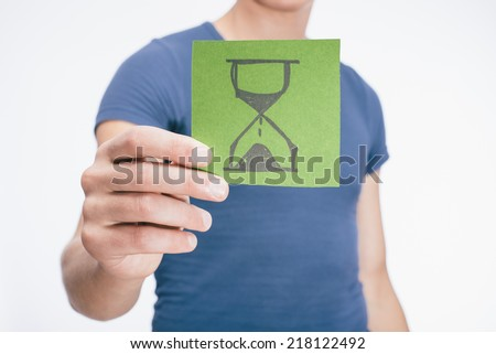 drawing a picture in his hand hourglass - stock photo