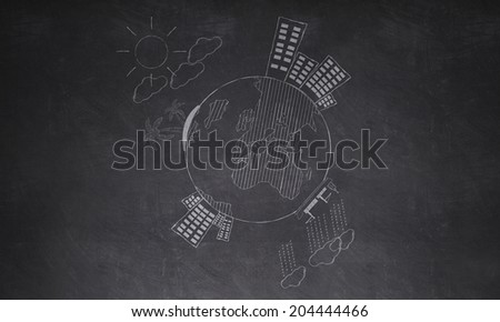 Drawing around the world on wall - stock photo