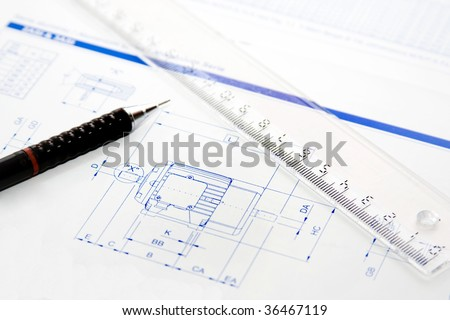 Drawing board with pen, ruler and project - stock photo