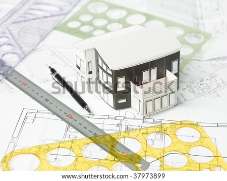 Drawing compass, pen and ruler on blueprints