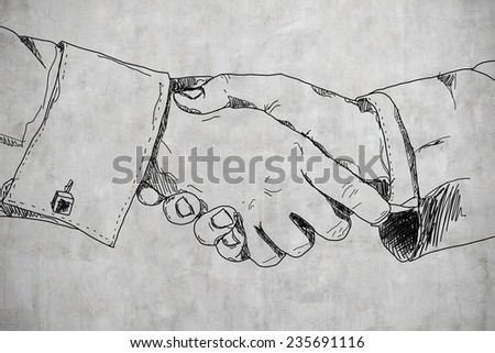 drawing handshake on a concrete wall - stock photo