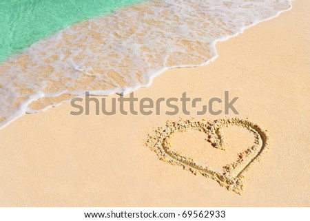 Drawing heart on beach - love concept - stock photo