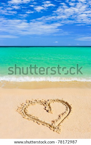 Drawing heart on beach - love concept