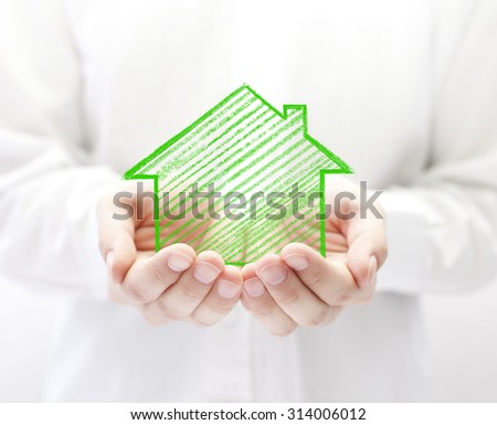Drawing house in hands  - stock photo
